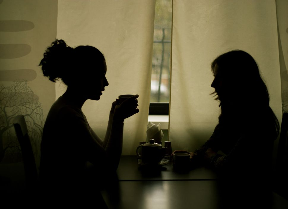 Silhouettes of Two Women Drinking Tea in Cafe