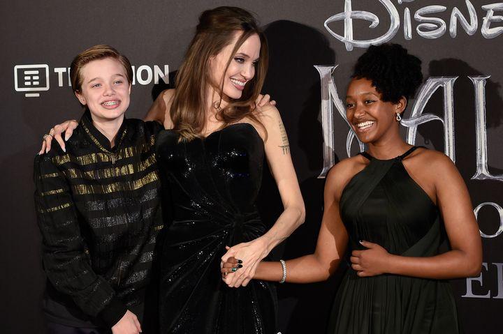 Angelina Jolie and her children Shiloh Jolie-Pitt (left) and Zahara Jolie-Pitt at a premiere in 2019.