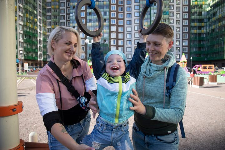 Irina and Anastasia Lagutenko play with their son, Dorian, at a playground in St. Petersburg, Russia, on July 2, 2020.