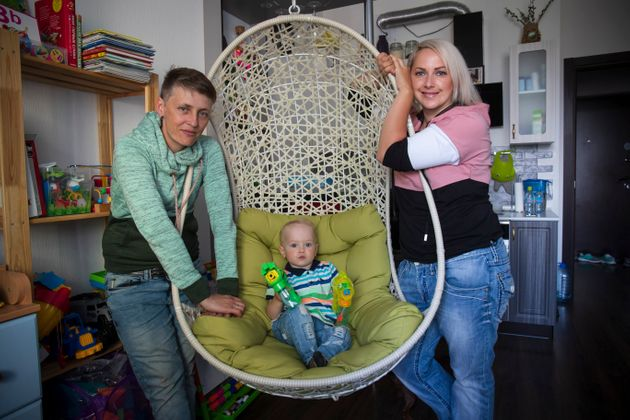 Irina, right, and Anastasia Lagutenko pose with their son, Dorian, in St. Petersburg, Russia, on July...