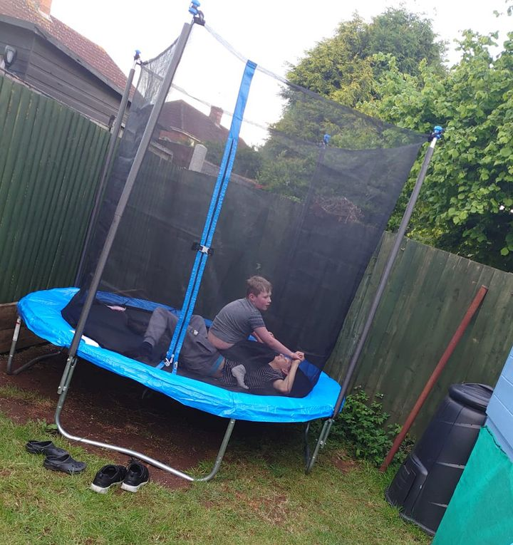 Stanley and Nathan playing on the trampoline provided by Action for Children