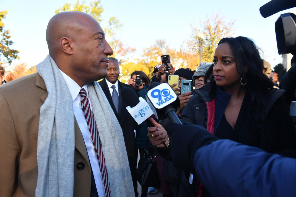 Natasha Alford (right) and TheGrio owner Byron Allen, in front of the Supreme Court in November 2019.