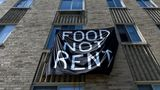 A banner hung by residents of the Meridian Heights apartment building calls for rent cancellation in the Columbia Heights neighborhood of Washington, U.S., May 25, 2020. REUTERS/Erin Scott