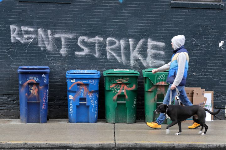 A pedestrian walks past graffiti in Seattle's Capitol Hill neighborhood. With millions of people suddenly out of work, some t
