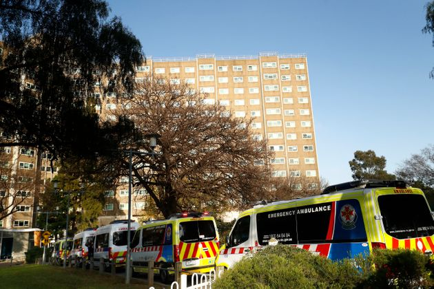 Ambulances line up outside the North Melbourne Public Housing tower complex last