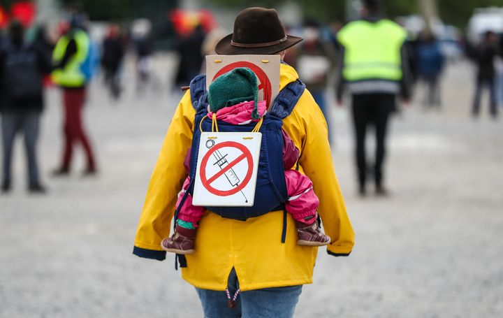 A protester at rally in Stuttgart, Germany, wears a sign signaling opposition to a coronavirus vaccine, May 2, 2020.