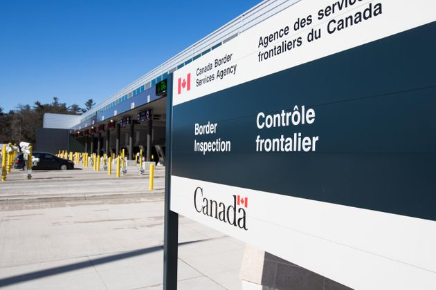 A vehicle enters a Canadian border station in Lansdowne, Ont., on March 22, 2020. The U.S.-Canada border...