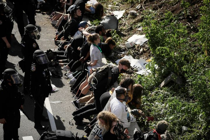 FILE—In this file photo from June 1, 2020, police detain protesters along Interstate 676 in Philadelphia in the afterma