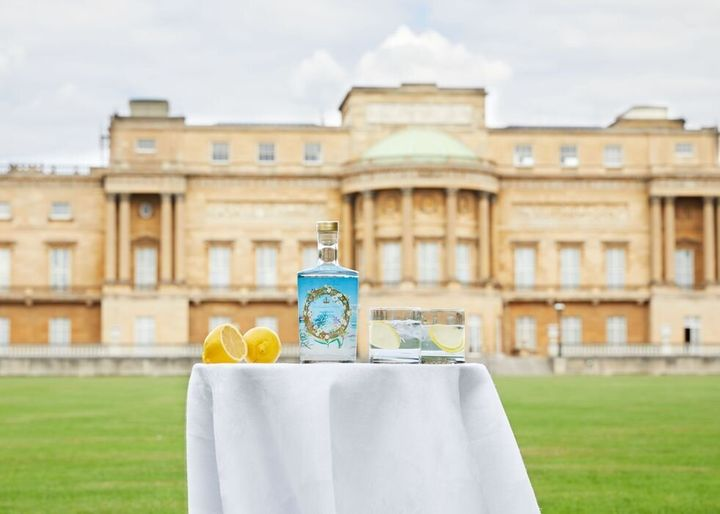 A bottle of the official Buckingham Palace gin in front of the palace. The Queen prefers hers with a slice of lemon and two ice cubes mixed with Dubonnet.