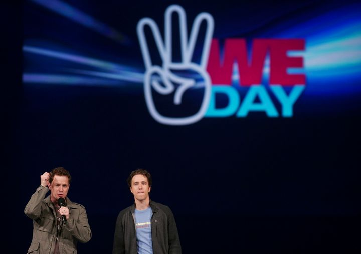 Marc, left, and Craig Kielburger, co-founders of the charity Free the Children, speaks at the charity's We Day celebrations in Kitchener, Ontario, Thursday, February 17, 2011.