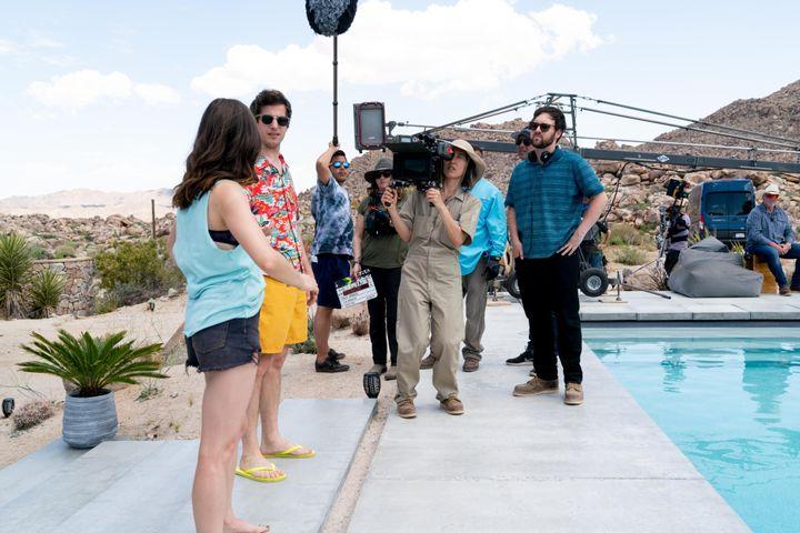 "Max Barbakow and cinematographer Quyen Trandirect Samberg andMilioti on the set of ""Palm Springs."""