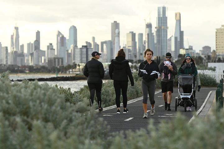 Melburnians exercise along Elwood Beach on July 13, 2020 in Melbourne, Australia. Metropolitan Melbourne and the Mitchell shire are in lockdown following the rise in COVID-19 cases through community transmissions.