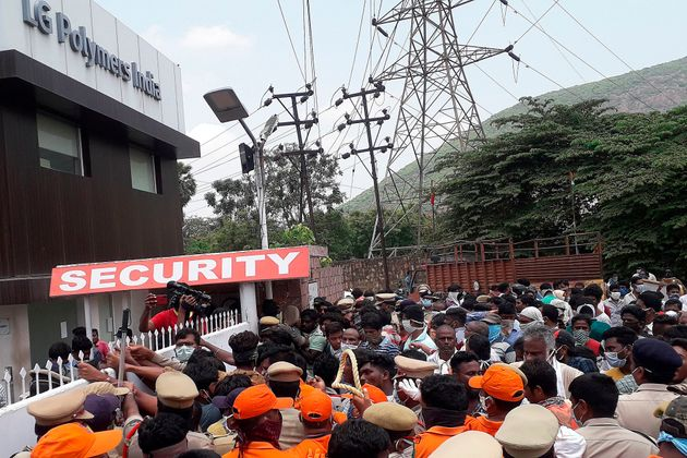 Residents protest in front of LG Polymers plant demanding justice to the gas leak victims, in Visakhapatnam,...