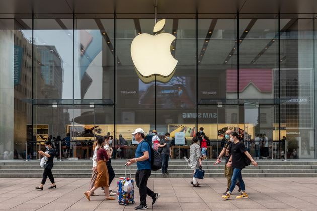SHANGHAI, CHINA - JUN 01: People walk by an Apple store at Nanjing Road Walking Street on June 1, 2020...