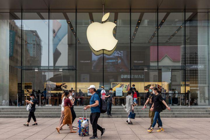 SHANGHAI, CHINA - JUN 01: People walk by an Apple store at Nanjing Road Walking Street on June 1, 2020 in Shanghai, China. (P