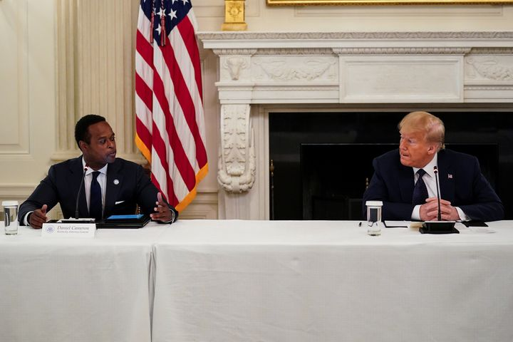 """Cameron, shown here with President Donald Trump, has said his challenges to Beshear's coronavirus orders would be """"unnecessar"""