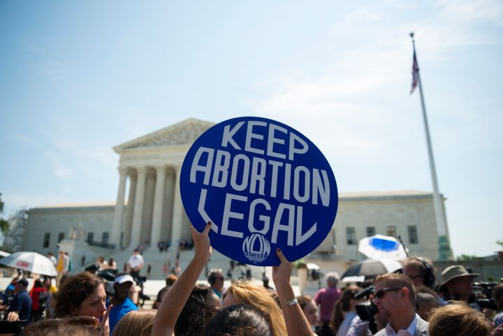 Abortion rights supporters celebrate in front of the U.S. Supreme Court after the court, in a 5-3 ruling, struck down a Texas