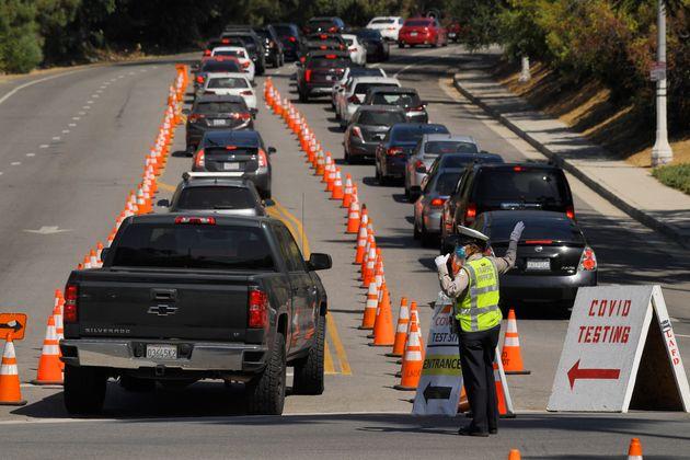 People wait in line for coronavirus testing at Dodger Stadium, July 14, in Los Angeles. (AP Photo/Mark...