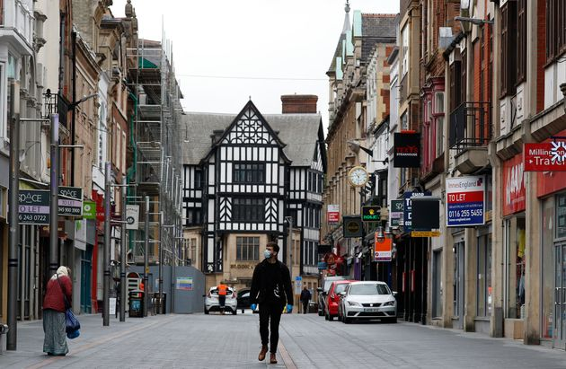 A man walks down a near empty shopping street in Leicester, England, on July 1, 2020. Leicester became...