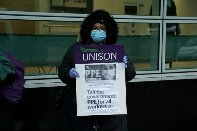 A hospital worker at a protest in