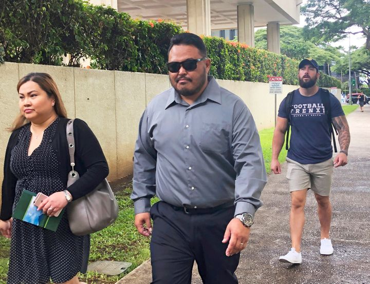 Former Honolulu police officer Reginald Ramones, seen center last September, is scheduled to be sentenced next week. Ramones pleaded guilty to knowing Rabago committed a civil rights violation and not informing authorities about it.