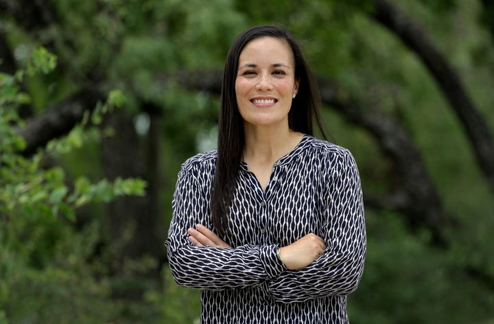 Gina Ortiz Jones, the Democratic nominee for a House seat in West Texas, poses for a photo, Friday, Aug. 10, 2018, in San Ant