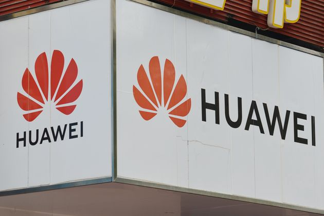 A Huawei sign appears outside a location in Fuyang, China, on July 15, 2020. Britain's decision to ban...