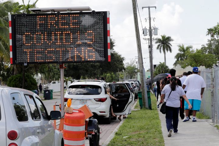 People wait in line outside of a COVID-19 testing site during the coronavirus pandemic on July 16 in Opa-locka, Florida.