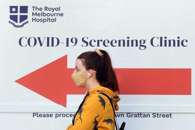 A woman queues outside a COVID-19 coronavirus testing venue Thursday at The Royal Melbourne Hospital...