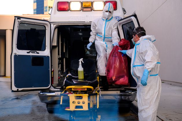 EMTs cleanse their materials outside Memorial West Hospital where coronavirus disease (Covid-19) patients...