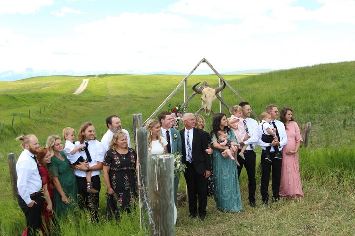 The families of Kadee and Jaxson Jensen pose at the Alberta-Montana border. The COVID-19 pandemic has shuttered non-essential travel between Canada and the U.S., leaving families to get creative with seeing each other.