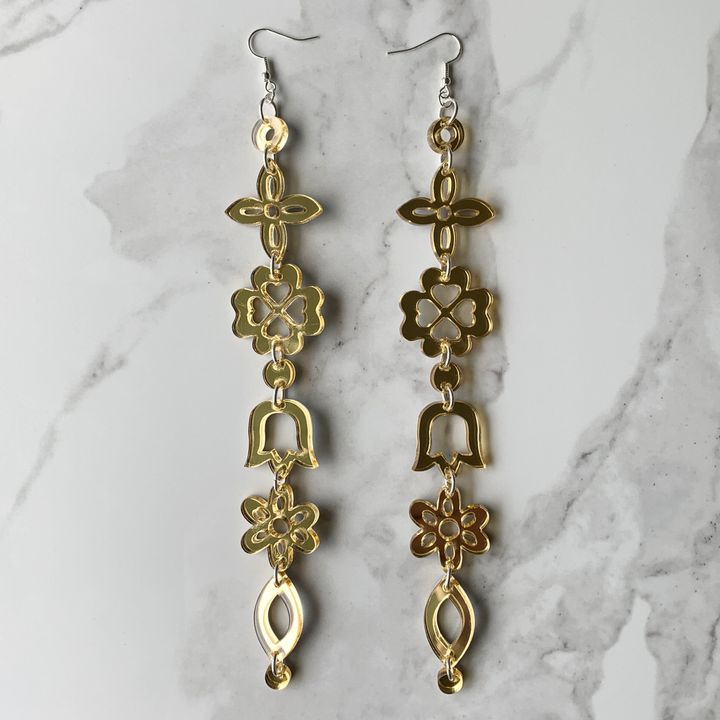 Medicine Florals Earrings in gold. Price on request.