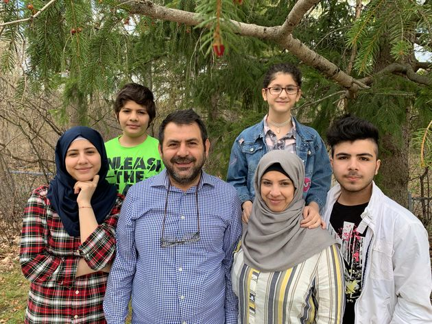 The Abou Rshd family. Emad Abou Rshd and his wife, Lamis, centre, with their children, from left clockwise:...