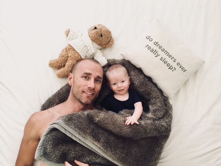 Kevin Atherton and a newborn Luca.