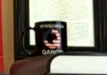 A closer look at the QAnon coffee mug behind Sergeants Benevolent Association President Ed Mullins.