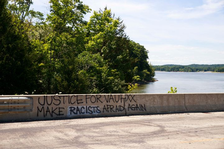 """Graffiti reading """"Justice for Vauhxx"""" and """"Make racists afraid again"""" seen on the causeway near the McCord property where Vau"""
