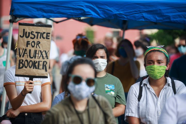 A protester holds a placard that says Justice for Vauhxx Booker during a community protest against racism on July 6.