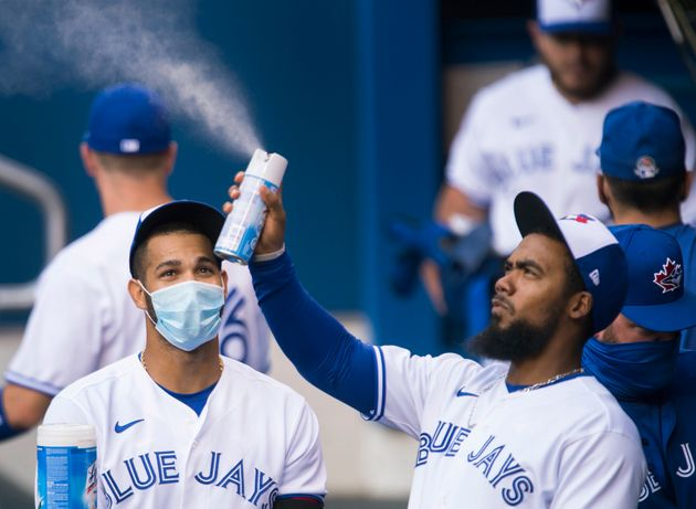 Toronto Blue Jays left fielder Lourdes Gurriel Jr., left, watches teammate Teoscar Hernandez, right,...