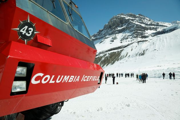 Tourists walk on the Athabasca Glacier in Jasper National Park, on May 7, 2014. RCMP in Alberta said...