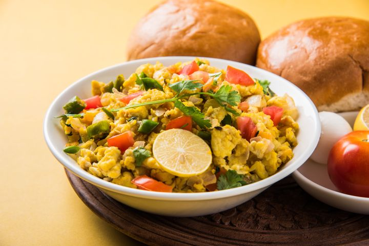 Masala Anda Bhurji of egg bhurji or Spicy scrambled eggs with bread or pav or paav slices and salade, anda bhurji paav