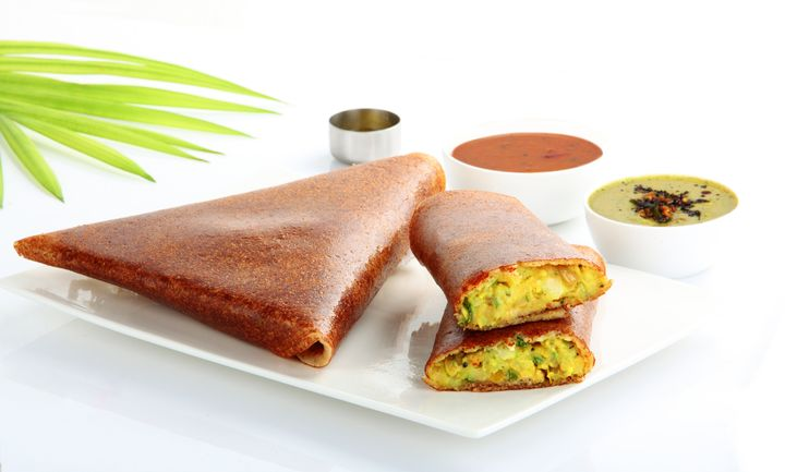 Masala Dosa is made by stuffing by a dosa with lightly cooked filling of potatoes, fried onions and spices. This can be served with chutney and sambar. This can be eaten for breakfast.