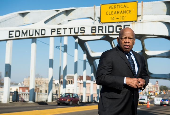 Rep. John Lewis stands on the Edmund Pettus Bridge in Selma, Alabama, in between television interviews on Feb. 14, 2015.