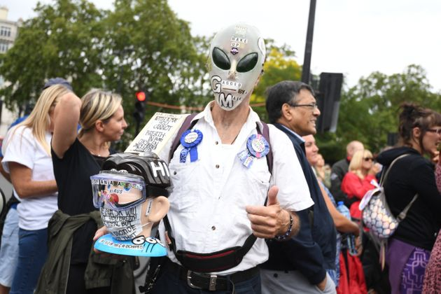 People attend a protest against the wearing of masks during the coronavirus outbreak, in Hyde Park,