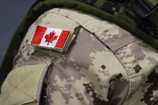 A Canadian flag patch is shown on a soldier's shoulder in Trenton, Ont., on Oct. 16, 2014. The Canadian...