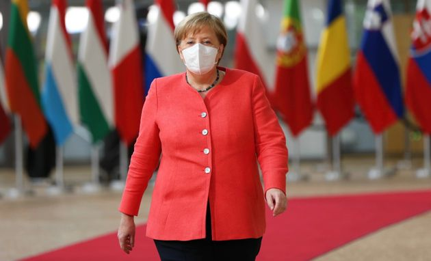 BRUSSELS, BELGIUM - JULY 17: German Chancellor Angela Merkel wearing a face mask as a precaution against...