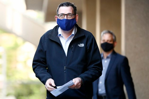 Victorian Premier Daniel Andrews wears a face mask as he walks in to the daily briefing on July 19, 2020...