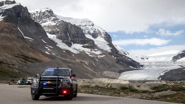 An RCMP cruiser sits in front of the Columbia Icefield near Jasper, Alta. on July 19,