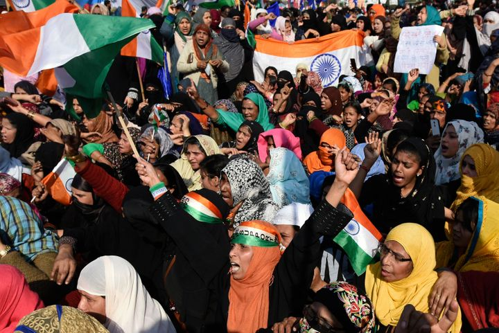 Protesters raise slogans and wave the tricolor ahead of their march to Home Minister Amit Shah's residence, at Shaheen Bagh, on February 16, 2020.