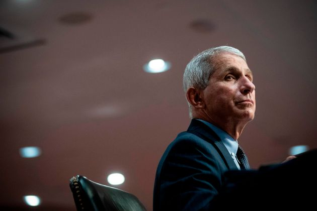 Dr. Anthony Fauci, the United States' top infectious disease expert, listens during a Senate committee...