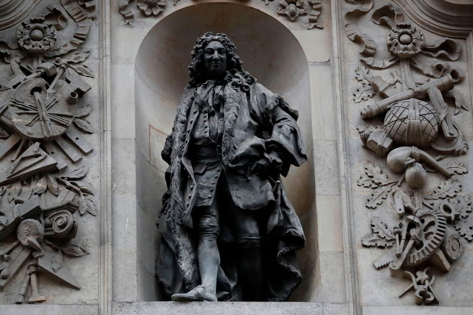 A statue of English merchant and slave trader Sir John Cass is mounted on the wall of the Sir John Cass Foundation in central London